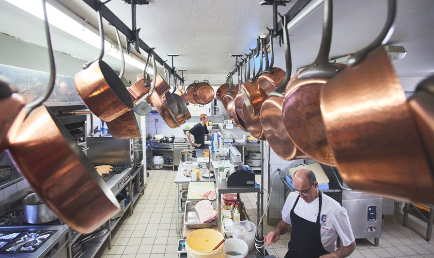 Tante Yvonne restaurant kitchen next to LYON with copper pans and Bernard Chemarin